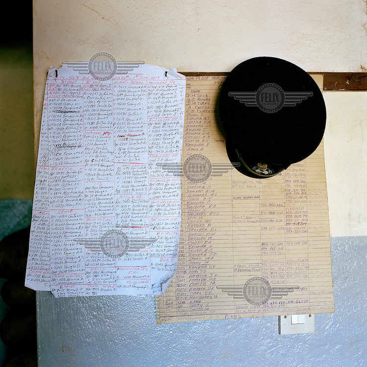 A duty roster hangs on the wall at the divisional headquarters and central police station in Makeni.