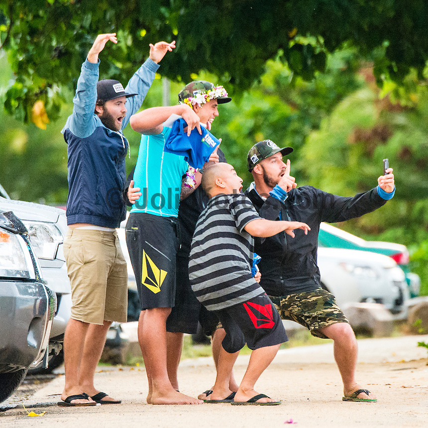 North Shore, Oahu, Hawaii (Sunday, Dec. 1, 2013) Dylan Payne (HAW), Jason Shibata (HAW) and  Matt Bemrose (AUS) pose for a selfie with Ezekiel. -- Hawaii's own Ezekiel Lau, 20, posted the largest victory of his young career today by winning the prestigious 39th annual VANS World Cup of Surfing at Sunset Beach - the second stop of the Vans Triple Crown of Surfing. Lau's win earned him $40,000 and sees him close the year at 35th position on the ASP world rankings. While that doesn't qualify him for next year's elite World Championship Tour, it does guarantee him an excellent seed. He also holds a shared lead on the coveted Vans Triple Crown series rankings with Michel Bourez (PYF) heading into the third and final event of the series - the Billabong Pipe Masters, where he is a local wildard entry.<br /> <br /> Lau made a late tube-riding charge from behind to turn the tables on Damien Hobgood (USA) and Raoni Monteiro (BRA) in the latter half of the 30-minute final. Fourth place was Frederico Morais, (PRT), who was announced the JN Chevrolet Rookie of the 2013 Vans Triple Crown. Lau went on the hunt and found his way onto the biggest waves of the final that also offered high-scoring tube riding potential. His final scoreline was 15.5 points out of 20 (8.67 and 6.83 point rides). Hobgood was second on 14.3; Monteiro third with 12.33, and Morais on 7.16.Photo: joliphotos.com