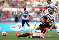 Calcio, Serie A: Roma vs Juventus. Roma, stadio Olimpico, 30 agosto 2015.<br /> Roma&rsquo;s Edin Dzeko and Juventus&rsquo; Leonardo Bonucci, right, fight for the ball during the Italian Serie A football match between Roma and Juventus at Rome's Olympic stadium, 30 August 2015.<br /> UPDATE IMAGES PRESS/Isabella Bonotto