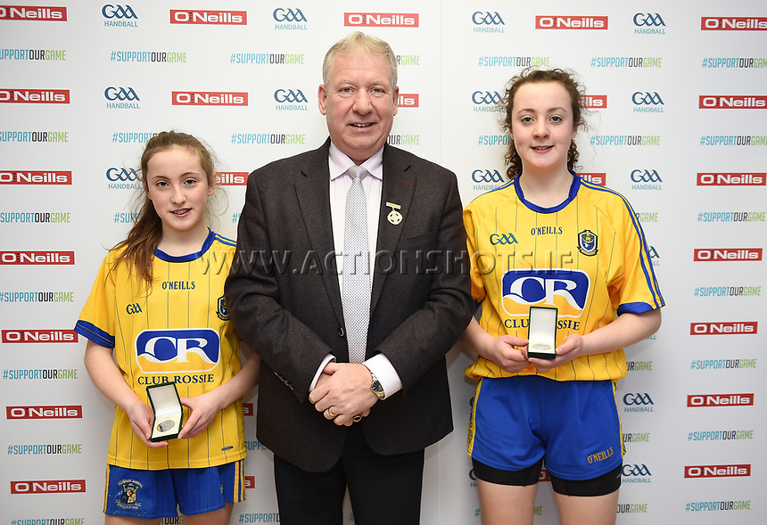 19/03/2018; 40x20 All Ireland Juvenile Championships Finals 2018; Kingscourt, Co Cavan;<br /> Girls Under-15 Doubles; Roscommon (Siobhan/Aishling Treacy) v Cork (Celine Kelleher/Muireann O&rsquo;Brien)<br /> Siobhan and Aishling Treacy with GAA Handball President Joe Masterson<br /> Photo Credit: actionshots.ie/Tommy Grealy