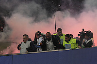 photographers seeking shelter from   smoke bombs and firecrackers thrown onto the pitch by Napoli's fans, prior to the Italy Cup final soccer match between ACF Fiorentina and SSC Napoli at the Olimpico stadium in Rome, Italy, 03 May 2014