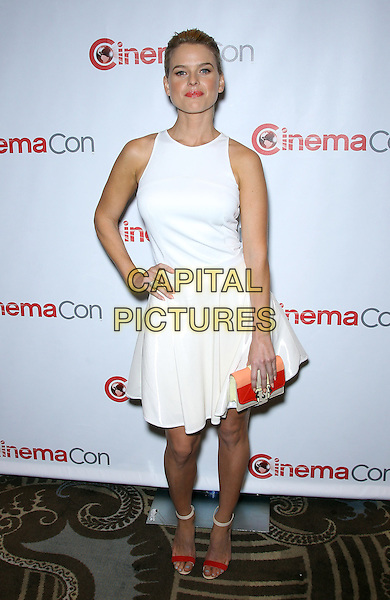 Alice Eve.Paramount Pictures hosts opening night event at CinemaCon 2013 at Caesars Palace, Las Vegas, NV., USA..April 15th, 2013.full length dress clutch bag pink orange open toe shoes sandals white sleeveless hand on hip red.CAP/ADM/MJT.© MJT/AdMedia/Capital Pictures