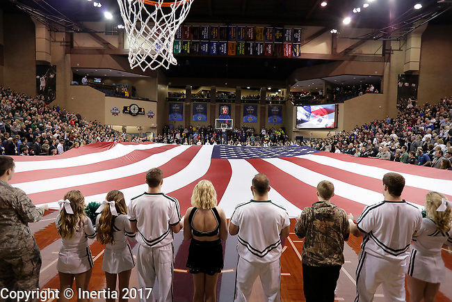 SIOUX FALLS, SD: MARCH 25:  Service members, cheerleaders and others hold the American flag as the National Anthem is played prior to the Men's Division II Basketball Championship game on March 25, 2017 at the Denny Sanford Premier Center in Sioux Falls, SD. (Photo by Dick Carlson/Inertia)