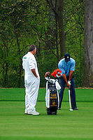 Masters Golf Tournament 2005, Augusta National Georgia, USA. Tiger Woods getting ready to hit a 9 iron onto the 11th hole, White Dogwood<br /> <br /> Champion 2005 - Tiger Woods <br /> <br /> Note: There is no property release or model release available for this image.
