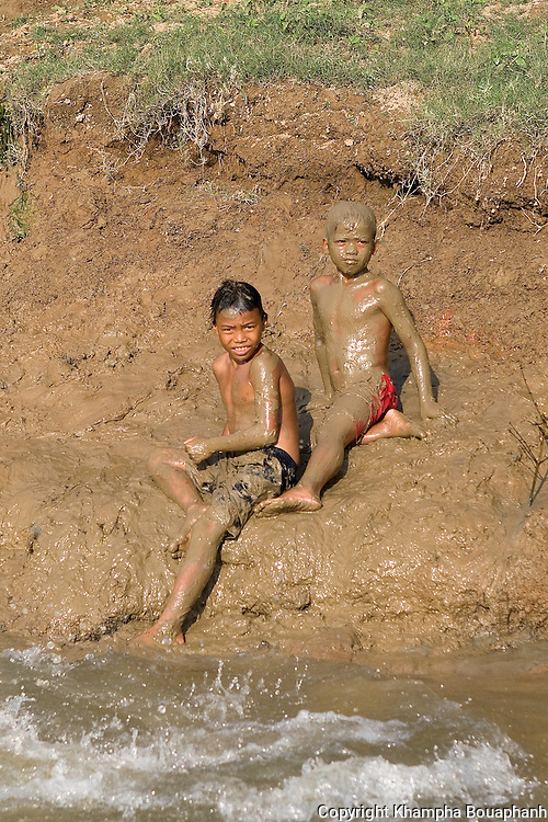 Local boys play on the banks of the Ngum River in Tha Ngon, Laos on October 31, 2009.   (Photo by Khampha Bouaphanh)