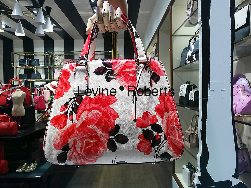 Kate Spade bags on display in the Kate Spade boutique on Bleecker Street in New York on Tuesday, February 7, 2017. Bowing to pressure from an activist shareholder, Caerus Investors, Kate Spade & Co. is reported to be exploring a sale of the company.(© Richard B. Levine)