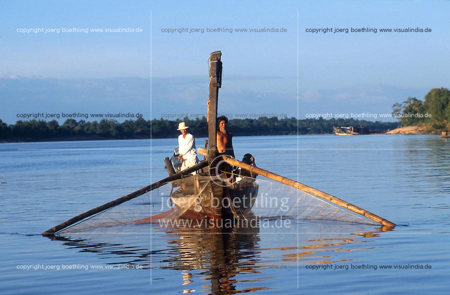 CAMBODIA Mekong river near Kratie, fishing boat / KAMBODSCHA Mekong Fluss bei Kratie, Fischer mit Boot, der Mekong hat eine hohe Artenvielfalt an Flussfischen