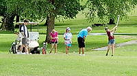 Photo submitted<br /> Siloam Springs Country Club golf pro Bob Abbey works with young golfers during Junior Golf Camp at Siloam Springs Country Club.