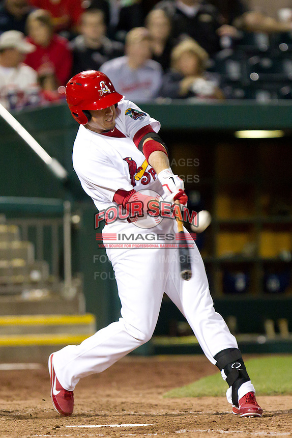 Allen Craig (44) of the St. Louis Cardinals makes contact on a ball during a game against the Tulsa Drillers on April 29, 2011 at Hammons Field in Springfield, Missouri. Craig played for the Springfield Cardinals during his injury rehab.   Photo By David Welker/Four Seam Images.