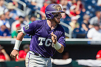 TCU Horned Frogs catcher Evan Skoug (9) runs to first base against the Texas Tech Red Raiders in Game 3 of the NCAA College World Series on June 19, 2016 at TD Ameritrade Park in Omaha, Nebraska. TCU defeated Texas Tech 5-3. (Andrew Woolley/Four Seam Images)