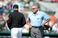 Home plate umpire John Hirschbeck talks with manager Buck Showalter during a spring training game between the Baltimore Orioles and Toronto Blue Jays at Ed Smith Stadium on March 7, 2013 in Sarasota, Florida.  Balitmore defeated Toronto 11-10.  (Mike Janes/Four Seam Images)