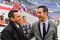 Colorado Rapids head coach Pablo Mastroeni talks with New York Red Bulls head coach Mike Petke prior to a Major League Soccer (MLS) match at Red Bull Arena in Harrison, NJ, on March 15, 2014.