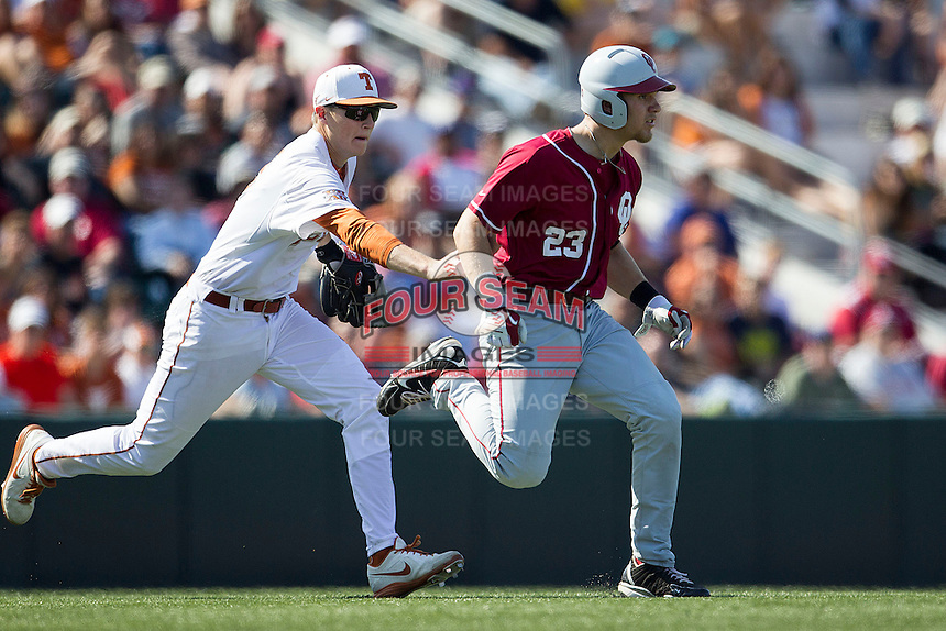 Texas Longhorns third baseman Erich Weiss #6 reaches to tag out Oklahoma Sooners baserunner Kolbey Carpenter #23 during a rundown in the NCAA baseball game on April 6, 2013 at UFCU DischFalk Field in Austin, Texas. The Longhorns defeated the rival Sooners 1-0. (Andrew Woolley/Four Seam Images).