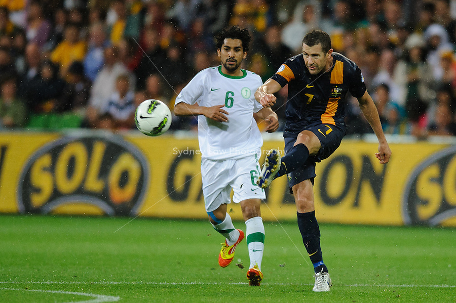 Brett EMERTON (7) of Australia kicks the ball during the FIFA 2014 World Cup Group D Asian Qualifier match between Australia and Saudi Arabia at AAMI Park in Melbourne, Australia...This image is not for sale on this web site. Please contact Southcreek Global Media for licensing:.Toll Free: 1.800.934.5030.Canada: 701 Rossland Rd. East, Suite 315, Whitby, Ontario, Canada, L1N 9K3.USA: 10792 Baron Dr, Parma OH, USA 44130.Web: http://southcreekglobal.net/ and http://southcreekglobal.com/