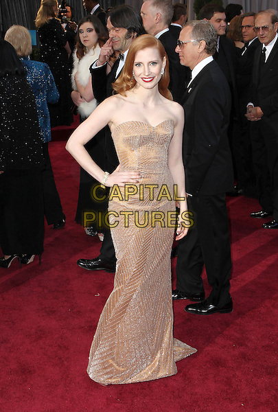 Jessica Chastain (wearing Armani Prive).85th Annual Academy Awards held at the Dolby Theatre at Hollywood & Highland Center, Hollywood, California, USA..February 24th, 2013.oscars full length blush strapless dress gown sweetheart neckline gold sparkly hand on hip.CAP/ADM/SLP/COL.©Colin/StarlitePics/AdMedia/Capital Pictures