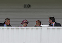 Her Majesty the Queen chats to Prince Philip, Duke of Edinburgh during the Cartier Queens Cup Final match between King Power Foxes and Dubai Polo Team at the Guards Polo Club, Smith's Lawn, Windsor, England on 14 June 2015. Photo by Andy Rowland.