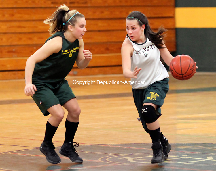 WATERBURY, CT-21 November 2011-112111CM03-  Holy Cross' Jackie Druan drives past teammate and defender, Angela Ariola during practice Monday afternoon in Waterbury.  Monday was the team's first practice and will be lead by coach, Frank Lombardo.  Christopher Massa Republican-American
