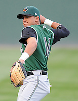 Infielder Ydwin Villegas (14) of the Augusta GreenJackets, Class A affiliate of the San Francisco Giants, in a game against the Greenville Drive on April 7, 2011, at Fluor Field at the West End in Greenville, South Carolina. (Tom Priddy / Four Seam Images)