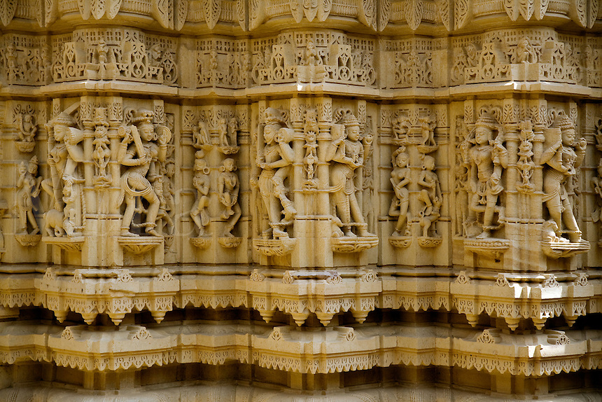 Hand carved GOLDED SANDSTONE DIVAS or Celestial Beings inside a JAIN TEMPLE in the JAISALMER FORT - RAJASTHAN, INDIA  .