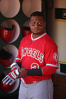 OAKLAND, CA - APRIL 30:  Erick Aybar #2 of the Los Angeles Angels stands in the dugout before the game against the Oakland Athletics at O.co Coliseum on Thursday, April 30, 2015 in Oakland, California. Photo by Brad Mangin