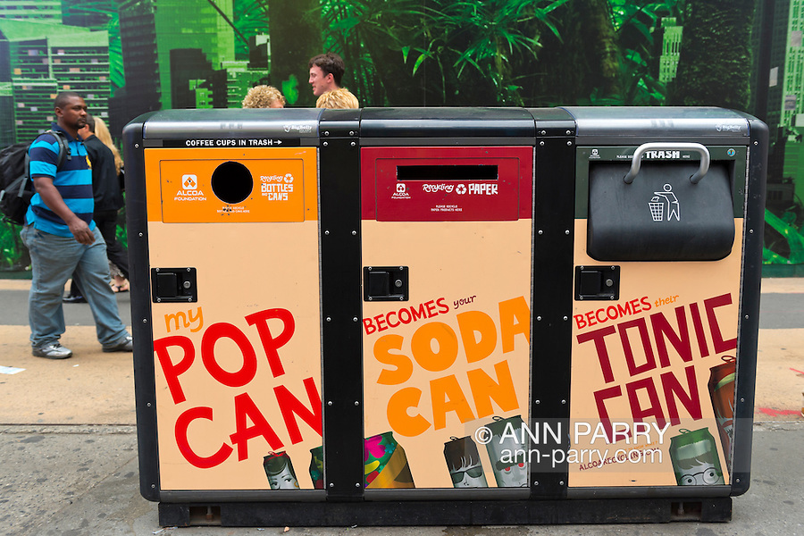 Manhattan, New York, U.S. - May 21, 2014 -  In Times Square is a solar powered 3 bin recycling system, for plastics, bottles and cans, and trash, during a pleasant Spring day in Manhattan.