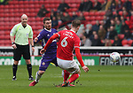 John Fleck of Sheffield Utd  tackles Liam Lindsay of Barnsley during the championship match at the Oakwell Stadium, Barnsley. Picture date 7th April 2018. Picture credit should read: Simon Bellis/Sportimage
