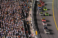 Jul. 5, 2008; Daytona Beach, FL, USA; NASCAR Sprint Cup Series fans cheer as driver Dale Earnhardt Jr (88) takes the lead from Denny Hamlin (11) during the Coke Zero 400 at Daytona International Speedway. Mandatory Credit: Mark J. Rebilas-