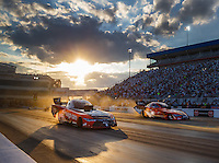 Sep 16, 2016; Concord, NC, USA; NHRA funny car driver Cruz Pedregon (near) races alongside Chad Head during qualifying for the Carolina Nationals at zMax Dragway. Mandatory Credit: Mark J. Rebilas-USA TODAY Sports