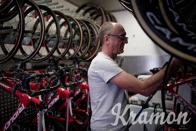 Lotto-Soudal mechanic Jean-Pierre Christiaens checking the tire pressure of all spare wheels in the truck ahead of Stage 14: San Vicente de la Barquer to Oviedo (188km)<br /> <br /> La Vuelta 2019<br /> <br /> ©kramon