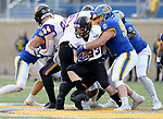 BROOKINGS, SD - NOVEMBER 16: Sam Schnee #23 of the Northern Iowa Panthers is brought down by Caleb Sanders #99 of the South Dakota State Jackrabbits during their game Saturday afternoon at Dana J. Dykhouse Stadium in Brookings, SD. (Photo by Dave Eggen/Inertia)