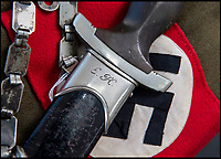 BNPS.co.uk (01202 558833)<br /> Pic: PhilYeomans/BNPS<br /> <br /> 'EK' for Erich Kempka.<br /> <br /> Sinister survivor from the heart of Hitler's Third Reich...<br /> <br /> The SS presentation dagger belonging to Hitler's trusted personal chauffeur - who's final mission was to collect the petrol to burn the Fuhrers body after his suicide at the Reich Chancellery has emerged for sale for £5000.<br /> <br /> SS-Obersturmbannfuhrer Erich Kempka fulfilled the key security role in the Fuhrer's entourage from 1936 until his death on April 30, 1945.<br /> <br /> The sinister 13ins dagger is engraved with Kempka's initials 'EK', along with the elite SS mark and the Nazi eagle adorning the handle.