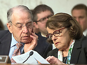"United States Senators Charles Grassley (Republican of Iowa), left, and Dianne Feinstein (Democrat of California), right, look over some notes as they hear testimony before the US Senate Committee on the Judiciary during ""an oversight hearing to examine the Parkland shooting and legislative proposals to improve school safety"" on Capitol Hill in Washington, DC on Wednesday, March 14, 2018.<br /> Credit: Ron Sachs / CNP"