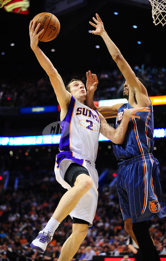 Jan. 26, 2011; Phoenix, AZ, USA; Phoenix Suns guard (2) Goran Dragic drives to the basket in the second half against the Charlotte Bobcats at the US Airways Center. The Bobcats defeated the Suns 114-107. Mandatory Credit: Mark J. Rebilas-