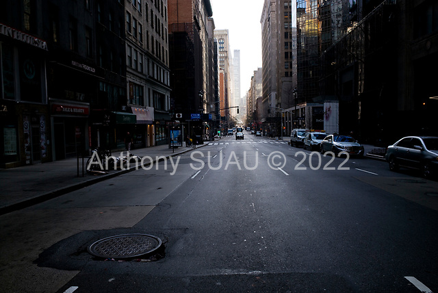 New York, New York<br /> March 20, 2020<br /> 4:28 PM<br /> <br /> Manhattan under the coronavirus pandemic. <br /> <br /> East-Broadway Manhattan at Friday rush-hour.<br /> <br /> Normally this street would be filled with cars and people.
