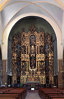 Altarpiece of high altar, 1698, by Joseph Sunyer, Eglise Notre Dame des Anges, Collioure, France. Richly carved and covered in gold leaf, this wooden altarpiece in tryptich depicts the Virgin of the Assumption in the centre, and at the top is the Eternal Father between Justice and Charity. Picture by Manuel Cohen.