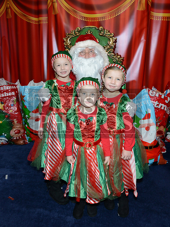 Aimee, Shauna and Georgia Rice with Santa at Drogheda Town Centre. Photo:Colin Bell/pressphotos.ie