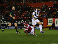Isaac Osbourne crucially tackles Dougie Imrie in the Aberdeen v St Mirren Scottish Communities League Cup match played at Pittodrie Stadium, Aberdeen on 30.10.12.