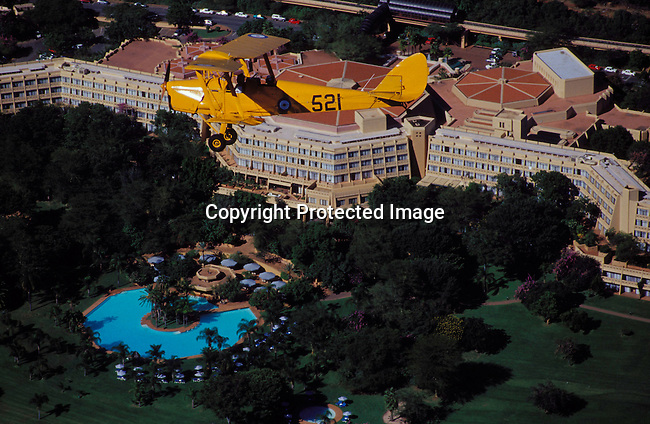 dihosun00003 Hotel An old plane called tiger moth May 9, 2003, flying over Sun City, South Africa. Exterior view from above of the hotel. These planes can be rented and are used by wealthy foreigners visiting the country..©Per-Anders Pettersson/iAfrika Photos.