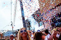 People watch as confetti is shot into the air during St. Peter's Fiesta in Gloucester, Massachusetts, USA.