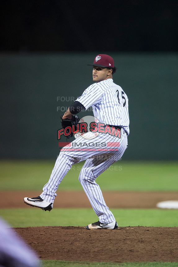Idaho Falls Chukars relief pitcher Domingo Pena (15) delivers a pitch during a Pioneer League game against the Great Falls Voyagers at Melaleuca Field on August 18, 2018 in Idaho Falls, Idaho. The Idaho Falls Chukars defeated the Great Falls Voyagers by a score of 6-5. (Zachary Lucy/Four Seam Images)