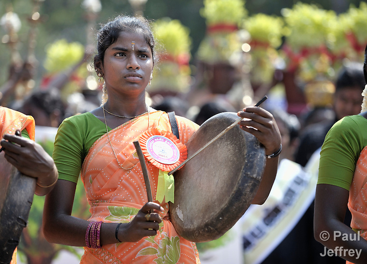 A participant in a march and rally celebrating International Women's Day in Madurai, a city in Tamil Nadu state in southern India.