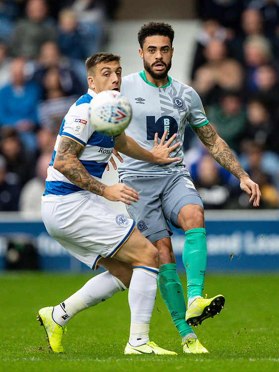 Blackburn Rovers' Derrick Williams competing with Queens Park Rangers' Jordan Hugill (left) <br /> <br /> Photographer Andrew Kearns/CameraSport<br /> <br /> The EFL Sky Bet Championship - Queens Park Rangers v Blackburn Rovers - Saturday 5th October 2019 - Loftus Road - London<br /> <br /> World Copyright © 2019 CameraSport. All rights reserved. 43 Linden Ave. Countesthorpe. Leicester. England. LE8 5PG - Tel: +44 (0) 116 277 4147 - admin@camerasport.com - www.camerasport.com