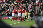 Nottingham Forest 2 Yeovil Town 5, 18/05/2007. City Ground, League One Play Off Semi Final 2nd Leg. Nottingham Forest players celebrating their second-half equaliser against Yeovil Town's Tyrell Forbes during the League One play-off semi-final match at the City Ground. Forest had won the first leg by 2 goals to nil at Yeovil the previous week but were defeated by 5 goals to 2 after extra time and missed out on the play-off final at Wembley. Yeovil went on to play Blackpool in the final for the one remaining promotion place to the Championship. Photo by Colin McPherson.