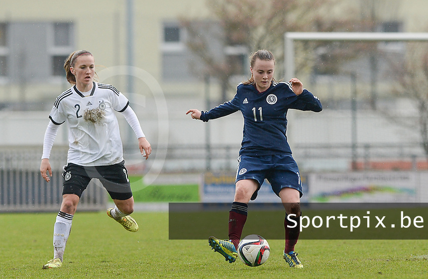 20150404 - FORST , GERMANY  : Scottish Kirsty Howat pictured with German Michaela Brandenburg (left) during the soccer match between Women Under 19 teams of Germany and Scotland , on the first matchday in group 5 of the UEFA Elite Round Women Under 19 at WaldseeStadion , Forst , Germany . Saturday 4th April 2015 . PHOTO DAVID CATRY