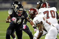 25 October 2011:  FIU defensive lineman James Jones (94) battles Troy offensive lineman James Brown (70) at the line of scrimmage in the first quarter as the FIU Golden Panthers defeated the Troy University Trojans, 23-20 in overtime, at FIU Stadium in Miami, Florida.