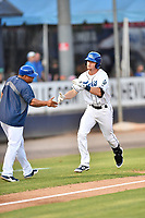 Asheville Tourists second baseman Taylor Snyder (28) is congratulated by manager Robinson Cancel after hitting a home run during a game against the Rome Braves at McCormick Field on August 31, 2018 in Asheville, North Carolina. The Braves defeated the Tourists 11-7. (Tony Farlow/Four Seam Images)