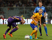 Calcio: amichevole Fiorentina vs Barcellona. Firenze, stadio Artemio Franchi, 2 agosto 2015.<br /> Fiorentina's Borja Valero, left, and FC Barcelona's Andres Iniesta fight for the ball during the friendly match between Fiorentina and FC Barcelona at Florence's Artemio Franchi stadium, 2 August 2015.<br /> UPDATE IMAGES PRESS/Riccardo De Luca