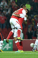 BOGOTA - COLOMBIA-11-05-2013: Wilder Medina (Izq.) jugador de Independiente Santa Fe, celebra el gol durante partido en el estadio Nemesio Camacho El Campin de la ciudad de Bogota, mayo 11 de 2013. Independiente Santa Fe y Boyaca Chico F.C., durante partido por la fecha 15 de la Liga Postobon I. (Foto: VizzorImage / Luis Ramirez / Staff).Wilder Medina (L) player of Independiente Santa Fe celebrates  a goal scored during game in the Nemesio Camacho El Campin stadium in Bogota City, May 11, 2013. Independiente Santa Fe and Boyaca Chico F.C.,during match for the round 15 of the Postobon League I. (Photo: VizzorImage / Luis Ramirez / Staff).