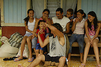 The children of a local family in Sevegre, Costa Rica prepare for a portrait.