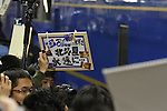 March 13, 2015, Tokyo, Japan - A man holds a placard  with message for the last train of the Hokutosei, an overnight express train departing for Sapporo at Ueno Station in Tokyo on March 13, 2015 in Tokyo, Japan. (Photo by Hiroyuki Ozawa/AFLO)
